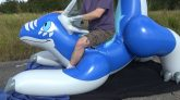 Riding-a-Blue-Pouncing-Dragon-Pool-Toy