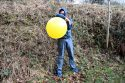 Blow-to-pop-yellow-balloon